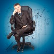 Businessman sitting on chair against graph background — Stock Photo #6768552