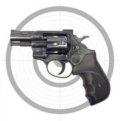 Black revolver and target — Stockfoto