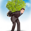 Businessman with eco lamp on back — Foto Stock