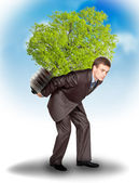 Businessman with eco lamp on back — Stock Photo