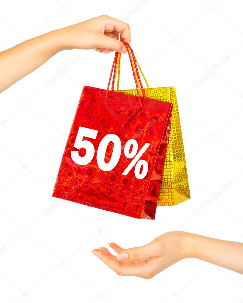 Woman's hands holding colorful shopping bags. Iisolated on white — Stock Photo #7003974