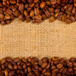 Stock Photo: Coffee grains on burlap background