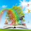 Magic book with a green tree and diferent animals - Stock Photo