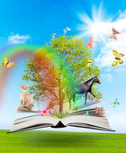 Magic book with a green tree and diferent animals — Stock Photo