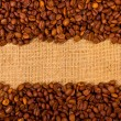 Coffee grains on burlap background — Stock Photo #7246925