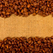 Coffee grains on the burlap background — Stock Photo