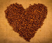 Heart shape created with coffee beans — Stock Photo