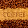 Coffee grains on burlap background — Stock Photo #7501823