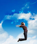 Girl jump on the background of the cloudy sky — Stock Photo