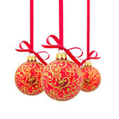 Three red Christmas balls in a row — 图库照片