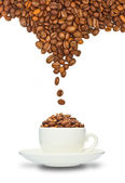 Cup and coffee beans — Stock Photo