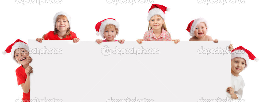 Happy kids  in christmas caps, holding the banner in his hand — Stock Photo #6883352