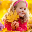 Happy girl in autumn park — Stock Photo #7343860