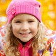 Happy girl in autumn park — Stock Photo #7343871