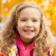 Happy girl in autumn park — Stock Photo #7343872