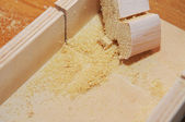 Sawdust on the plywood background — Stock Photo