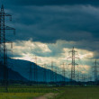 Electricity towers and cabels on cloud background - Foto de Stock
