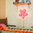 Children's bed and the included night lamp — Stock Photo