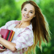 Young woman holds lot books — Stock Photo #6890757