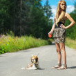 Stock Photo: Beautiful womwith dog leash