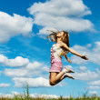 Young woman high jumps — Stock Photo #6890768