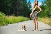 Beautiful woman with dog leash — Stock Photo