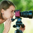 Young woman photographs - Stock Photo