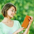 Young woman glasses read book — Stock Photo