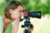 Young woman photographs — Stock Photo