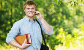 Business man glasses books phone — Stock Photo