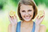 Attractive woman half lemon — Stock Photo