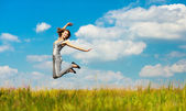 Young woman jumps — Stock Photo