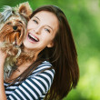 Woman beautiful young holds small dog — Stock Photo #6915585
