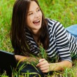Beautiful woman lying grass notebook - Stock Photo