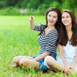 ������, ������: Two sisters sitting grass