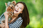 Woman beautiful young holds small dog — Stock Photo