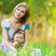Mother daughter sitting grass — Stock Photo #6994144