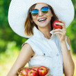Woman sunglasses hat apples — Stock Photo