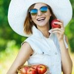 Woman sunglasses hat apples — Stock Photo