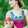 Stock Photo: Girl apples