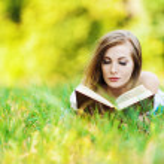 Woman grass reading book — Stock Photo