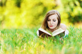 Woman grass reading book — Stock Photo