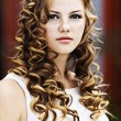 Girl serious curly — Stock Photo