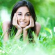 Portrait woman lying grass — Stock Photo