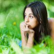 Girl lying grass - Stock Photo