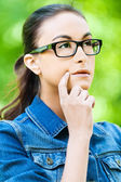 Young woman glasses dreams — Stock Photo