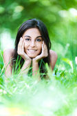 Portrait woman lying grass — Stock Photo
