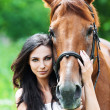 Portrait woman next horse — Stock Photo
