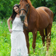 Stock Photo: Young woman next horse