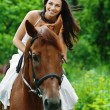 Stock Photo: Beautiful woman riding horse